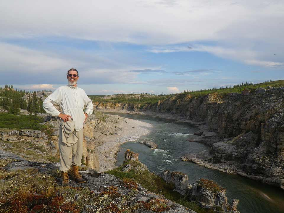 Brian Johnston stands on the rim of the third canyon above the Horton River.